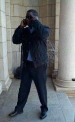 ellington_standing-with-phone